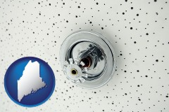 maine a fire sprinkler head mounted in an acoustic tile ceiling