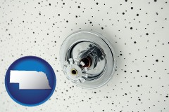 nebraska a fire sprinkler head mounted in an acoustic tile ceiling
