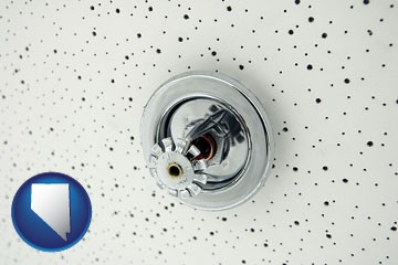 a fire sprinkler head mounted in an acoustic tile ceiling - with Nevada icon